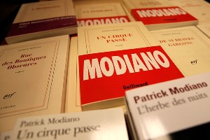 "Books by French novelist Patrick Modiano are on display in a Paris bookstore, Thursday, Oct. 9, 2014. Patrick Modiano of France, who has made a lifelong study of the Nazi occupation and its effects on his country, won the 2014 Nobel Prize in literature Thursday for what one academic called ""crystal clear and resonant"" prose. (AP Photo/Christophe Ena)"