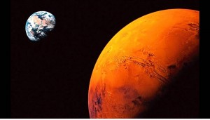 Planet Bumi dan Mars. Sumber gambar: www.telegraph.co.uk.