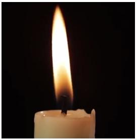 Nyala api pada lilin.
